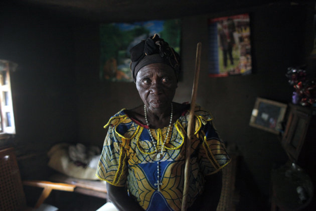 Charlotte Ntibatekereza, who lost her son, daughter in law and grandson in the fighting in Kiwanja July 25 2012, stands in her house Sunday Aug. 5, 2012. Ntibatekereza's son, his wife and her 4-year-old grandson were sleeping on the floor when a heavy-calibre bullet smashed through three walls of their home. her son and grandson died instantly. Her daughter-in-law is in the hospital recuperating from a bullet wound to the arm in fighting last week that pitted M23 rebels against the army. The rebels have the upper hand, holding a string of eastern town as regional leaders gather Monday in Kinshasa to try to resolve a rebellion that has forced more than a quarter million people from their homes. (AP Photo/Jerome Delay)