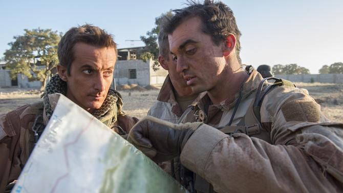 "In this picture released by the French Army Communication Audiovisual office (ECPAD) French soldiers check a map at an undisclosed location, north of the Malian capital, Bamako, Wednesday, Jan. 16, 2013. French troops pressed northward in Mali toward territory occupied by radical Islamists on Wednesday, military officials said, announcing the start of a land assault that will put soldiers in direct combat ""within hours."" (AP Photo/Arnaud Roine, ECPAD)"