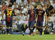 Barcelona&#39;s Argentinian forward Lionel Messi (C) celebrates after scoring in the match against Real Madrid on August 29, 2012. Barca take on Valencia looking to maintain their 100 per cent record, which is also shared by Real Valladolid and Rayo Vallecano