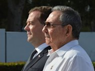 <p>Cuban President Raul Castro (R) and Russian Prime Minister Dmitry Medvedev are pictured during a visit to the Soviet Soldier Monument in Havana, on February 22, 2013. Castro expressed satisfaction with his talks this week with Medvedev, the daily Granma newspaper reported.</p>