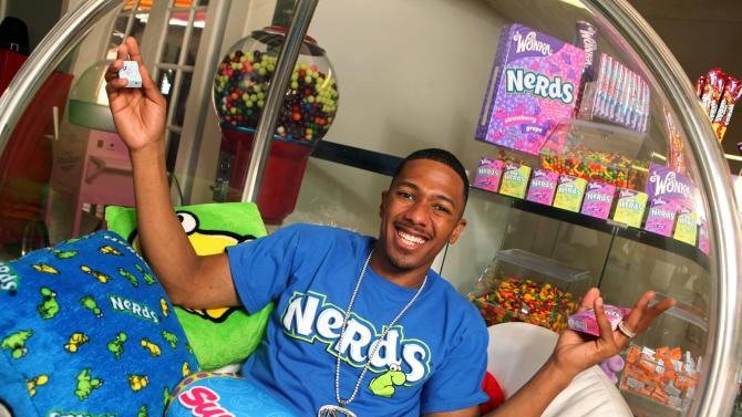 IMAGE DISTRIBUTED FOR WONKA – In this photo released on Tuesday, Oct. 23, 2012,Nick Cannon is seen in his Wonka Candy Room at home featuring SweeTARTS and NERDS in Los Angeles. (Photo by Casey Rodgers/Invision for WONKA/AP Images)