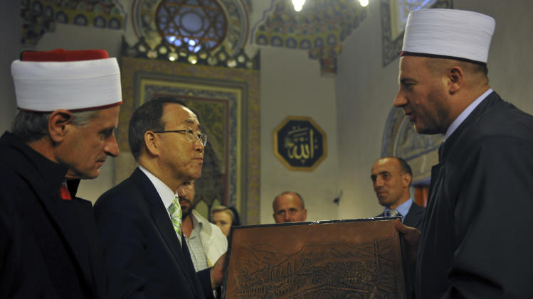 Secretary-General of the United Nations Ban Ki-moon, second left, is handed a gift from an Imam during his visit to the Sinan Pasha mosque in the western town of Prizren on Tuesday, July 24, 2012. The Secretary-General is on a regional tour of southeastern Europe. (AP Photo/Visar Kryeziu )