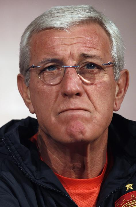 Marcello Lippi, coach of China's Guangzhou Evergrande, looks on during a news conference ahead of the Club World Cup in Agadir