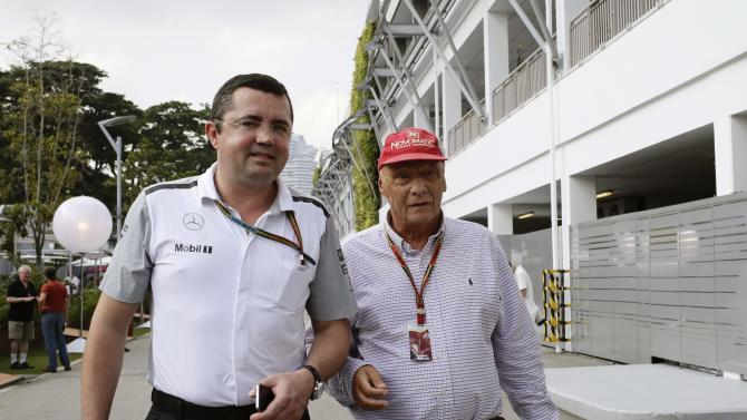 McLaren Formula One team racing director Bouiller and Mercedes Formula One team non-executive chairman Lauda walk at the paddock before the first practice session of the Singapore F1 Grand Prix