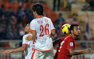 "Thailand's Sompong Soleb (R) battles with Vietnam's Nguyen Gia Tu during their AFF Suzuki Cup final group match in Bangkok on November 30. Thailand defeated Vietnam 3-1 to sweep into the semi-finals but the ""War Elephants"" face a stern test against Malaysia"