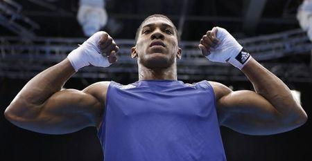 Britain's Anthony Joshua celebrates after he was declared the winner over Italy's Roberto Cammarelle following their Men's Super Heavy (+91kg) gold medal boxing match at the London Olympics