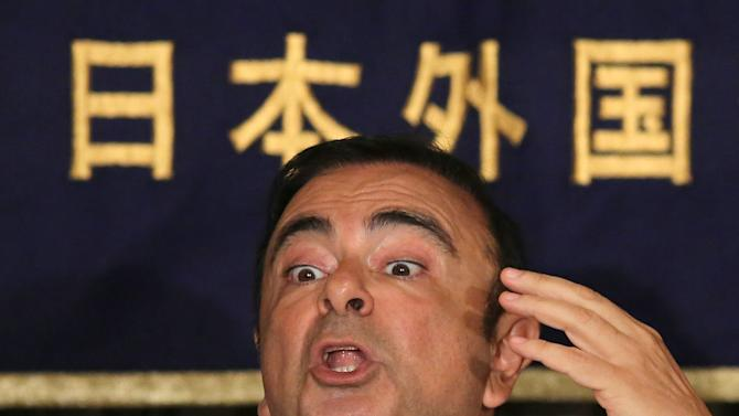 Nissan Chief Executive Carlos Ghosn answers questions from journalists during a press conference at Foreign Correspondents' Club of Japan in Tokyo, Thursday, July 17, 2014. Ghosn, who has long made a point of promoting women to management positions, said the Japanese Prime Minister Shinzo Abe's plan to boost female bosses to 30 percent by 2020 is too ambitious. The participation of women in Japan's workforce is very low by developed nation standards. Women make up 2.9 percent of manager-level and higher positions at Japanese companies employing 5,000 or more people. (AP Photo/Eugene Hoshiko)