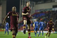 James Milner, right, hit a fine second for Manchester City