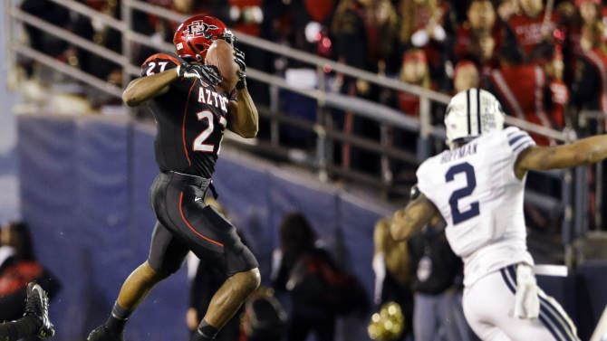 San Diego State defensive back Eric Pinkins (27) intercepts a pass in front of BYU wide receiver Cody Hoffman (2) during the second quarter of the Poinsettia Bowl NCAA college football game, Thursday, Dec. 20, 2012, in San Diego. Pinkins returned the interception into the end zone but the touchdown was nullified by a penalty. (AP Photo/Lenny Ignelzi)