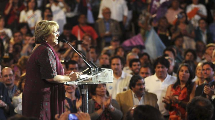 Chilean presidential candidate Michelle Bachelet of Nueva Mayoria (New Majority) delivers a speech during her closing campaign rally in Santiago