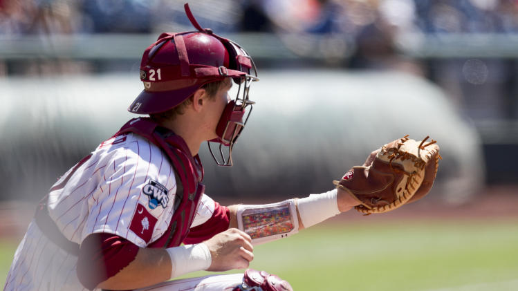 South Carolina catcher Grayson Greiner wears an arm band with plays against Kent State in the first inning of an NCAA College World Series elimination baseball game in Omaha, Neb., Thursday, June 21, 2012. (AP Photo/Nati Harnik)