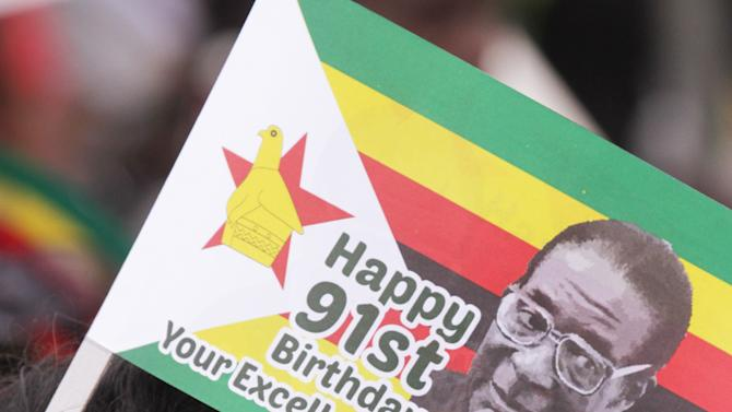 A supporter of Zimbabwes President  Robert Mugabe is seen during celebrations to mark his 91st birthday in the resort town of Victoria Falls, Saturday Feb, 28, 2015. Mugabe turned  91 on the 21st of February to become the worlds oldest leader with his supporters saying they will back him to run his full term until 2018 and beyond despite nagging questions about his health. (AP Photo/Tsvangirayi Mukwazhi)