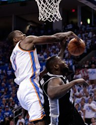 OKLAHOMA CITY, OK - JUNE 02:  Serge Ibaka #9 of the Oklahoma City Thunder blocks the attempted layup by DeJuan Blair #45 of the San Antonio Spurs in the second half in Game Four of the Western Conference Finals of the 2012 NBA Playoffs at Chesapeake Energy Arena on June 2, 2012 in Oklahoma City, Oklahoma. NOTE TO USER: User expressly acknowledges and agrees that, by downloading and or using this photograph, User is consenting to the terms and conditions of the Getty Images License Agreement.  (Photo by Brett Deering/Getty Images)