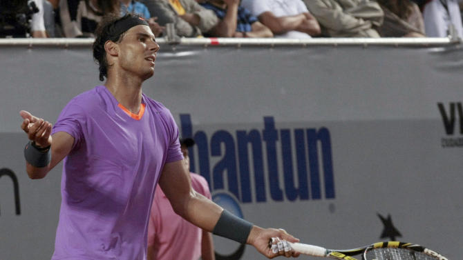 Spain's Rafael Nadal reacts during the VTR Open final tennis game against Argentina's Horacio Zeballos in Vina del Mar, Chile, Sunday, Feb. 10, 2013. Nadal lost to Zeballos 6-7 (2), 7-6 (6), 6-4 in Sunday's final of the VTR Open, the Spaniard's comeback tournament after seven months out with a torn tendon in his left knee. (AP Photo/Luis Hidalgo)