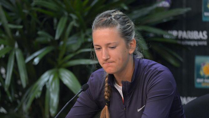 Victoria Azarenka, of Belarus, pauses during a news conference to announce that she has withdrawn from the BNP Paribas Open tennis tournament due to an ankle injury, Thursday, March 14, 2013, in Indian Wells, Calif. (AP Photo/Mark J. Terrill)