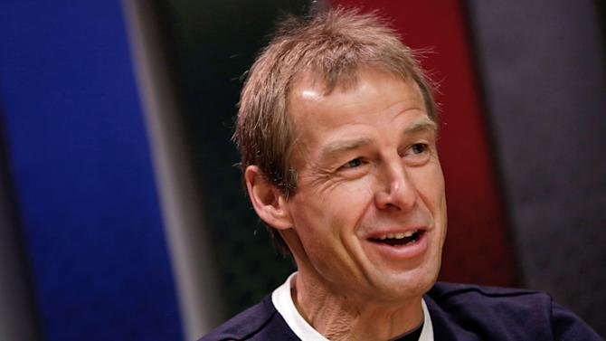 Jurgen Klinsmann, the United States men's national team soccer coach, answers questions during an interview Friday, April 5, 2013, in New York, (AP Photo/Richard Drew)