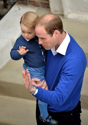Prince William and his son Prince George wave outside …