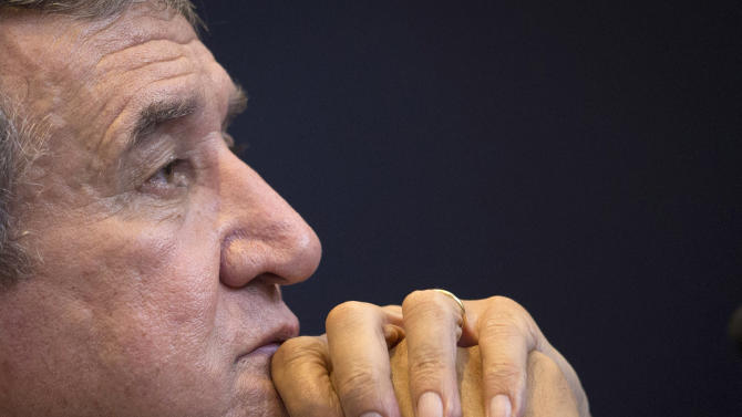 """FILE - In this March 25, 2013 file photo, Brazil's soccer team coordinator Carlos Alberto Parreira attends a news conference in Rio de Janeiro, Brazil. Brazil's assistant coach and former world champion Parreira says it's a """"joke"""" the Brazilian government took so long to start working on some of the infrastructure projects needed for the World Cup. With less than five months before the tournament, Parreira said this Monday Jan. 27, 2014 that he is disappointed with the country's preparations and accused the government of missing a huge opportunity to improve conditions for Brazilians. (AP Photo/Felipe Dana, File)"""
