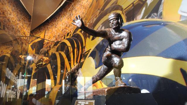 The 1997 Heisman Memorial Trophy presented to Charles Woodson sits on display at the newly opened football museum inside the renovated Schembechler Hall at the University of Michigan, Friday, April 18, 2014, in Ann Arbor, Mich