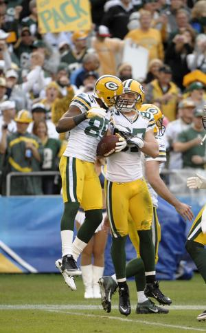 Green Bay Packers quarterback Aaron Rodgers, right, celebrates with teammate wide receiver Greg Jennings, left, after Jennings scored a touchdown against the San Diego Chargers in the third quarter during an NFL football game, Sunday, Nov. 6, 2011, in San Diego. (AP Photo/Denis Poroy)