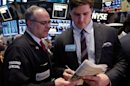 NFL draft prospect Luke Joeckel, right, of Texas A&M, signs an autograph during his visit to the trading floor of the New York Stock Exchange Wednesday, April 24, 2013. (AP Photo/Richard Drew)