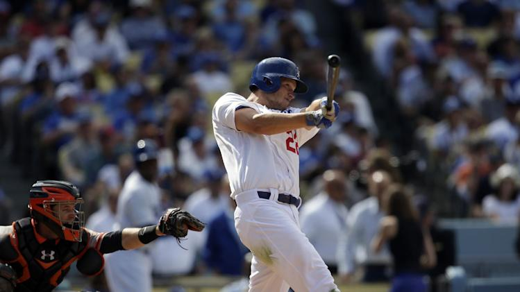 Los Angeles Dodgers' Clayton Kershaw hits a home run against the San Francisco Giants during the eighth inning of a season-opening baseball game in Los Angeles, Monday, April 1, 2013. (AP Photo/Jae C. Hong)