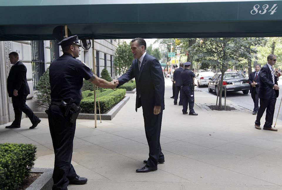 Republican presidential candidate, former Massachusetts Gov. Mitt Romney greets police officer Lombardi as he arrives for a finance event on 5th Ave in New York, Thursday, Aug. 9, 2012.  (AP Photo/Mary Altaffer)