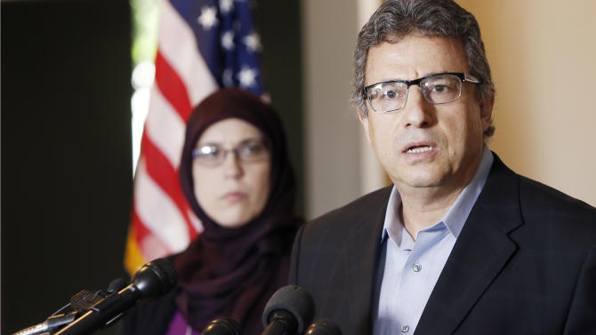 Muslim community leader Khalid Hamideh, right, and Ali Salem, Executive Director of Council on American-Islamic Relations, hold a news conference condemning the two gunmen who attempted to attack a contest for Muslim Prophet Muhammed cartoons, Monday, May 4, 2015, in Garland, Texas. A Garland police officer shot and killed both men. (AP Photo/Brandon Wade)