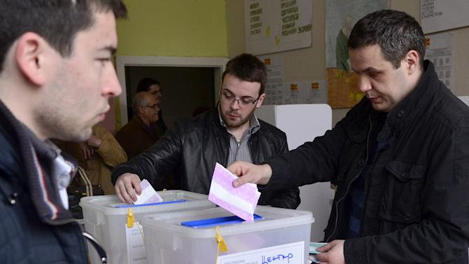 People cast their ballots in local elections at a polling station in Skopje, Macedonia, on Sunday, March 24, 2013. The small Balkan country hopes that free, transparent and peaceful local elections will help it strengthen its case for European Union membership. (AP Photo/Boris Grdanoski)