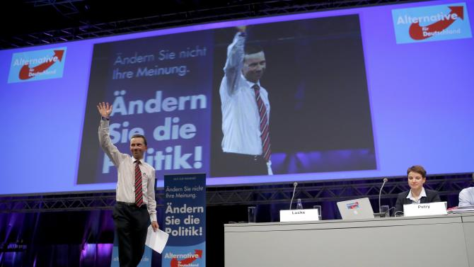 Lucke founder and co-chairman of AfD acknowledges applause next to AfD co-chairman Petry during party congress in Essen