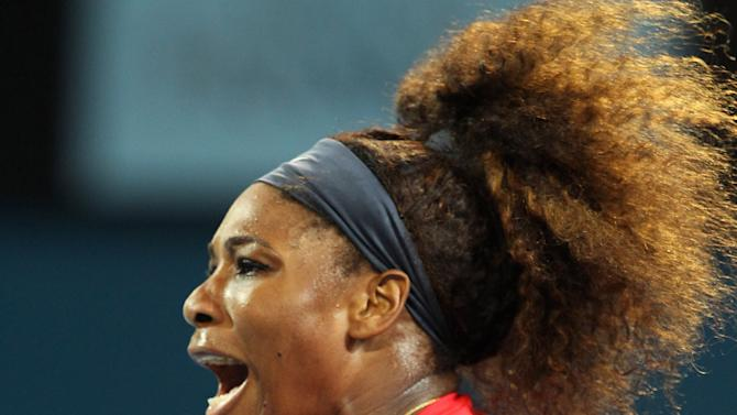 Serena Williams of the U.S. reacts to a point in her match against Alize Cornet of France during the Brisbane International tennis tournament in Brisbane, Australia, Tuesday, Jan 1, 2013.  (AP Photo/Tertius Pickard)