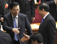 "File photo shows Bo Xilai (R), former leader of the Chinese megacity of Chongqing, shaking hands with Zhang Dejiang, Chongqing's new party head, on March 13. The public demise of Bo had brought ""great damage"" to the country and the ruling Communist Party, Zhang said on Monday"