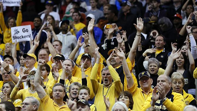 Wichita State fans celebrate during their team's 73-55 win over Pittsburgh in a second-round game in the NCAA college basketball tournament in Salt Lake City Thursday, March 21, 2013. Wichita State 73-55. (AP Photo/George Frey)