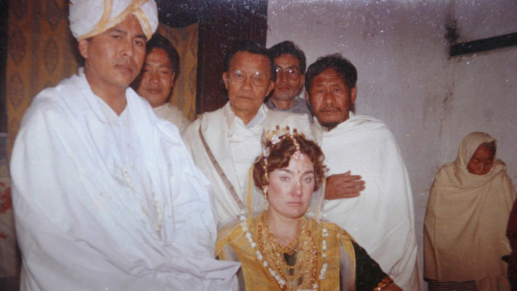 "This undated family photograph shows Jupiter Yambem during his marriage to Nancy, center. Jupiter was a banquet manager in the Windows on the World restaurant atop one of the towers, and was originally from the small northeastern Indian state of Manipur. His brother, Yambem Laba believes the U.S. had no choice but to wage war and hunt for Osama bin Laden. ""The WTC attack was the spark and the flame was the war,"" he says. Each anniversary, up to 150 family members and friends honor Jupiter's memory with a Hindu lunch, prayer ceremony and floral offerings to his portrait. With bin Laden's recent death, this year's gathering will be special, Laba says. ""The aftereffect of 9/11 is that the war on terrorism took a different turn,"" Laba says. ""Earlier you could say one man's terrorist is another man's freedom fighter, but that no longer held true."" (AP Photo)"