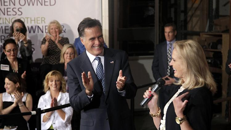 Republican presidential candidate, former Massachusetts Gov. Mitt Romney applauds as he listens to his wife Ann, at a campaign stop in Chantilly, Va., Wednesday, May 2, 2012. (AP Photo/Jae C. Hong)