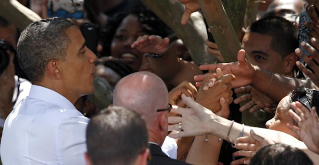 President Barack Obama shakes the hands of supporters during a rally at Norfolk State University in Norfolk, Va., Tuesday, Sept. 4, 2012. ( AP Photo/Steve Helber)