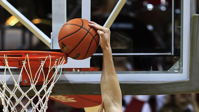 Indiana's Cody Zeller misses a dunk against Bryant's Andrew Scocca during the first half of an NCAA college basketball game, Friday, Nov. 9, 2012, in Bloomington, Ind. (AP Photo/Darron Cummings)