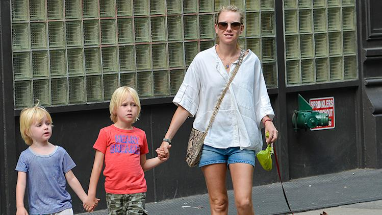 Naomi Watts and her sons walk their dog in New York