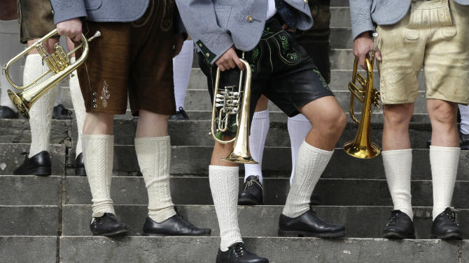 Musicians of the Oktoberfest orchestra arrive for the famous Oktoberfest beer festival concert in Munich, southern Germany, Sunday, Sept. 30, 2012. The world's largest beer festival, to be held from Sept. 22 to Oct. 7, 2012 will see some million visitors. (AP Photo/Matthias Schrader)
