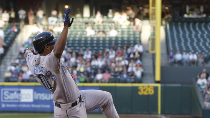 Toronto Blue Jays' Edwin Encarnacion scores in the first inning against the Seattle Mariners during a baseball game in Seattle, on Tuesday, Aug. 16, 2011. (AP Photo/Kevin P. Casey)