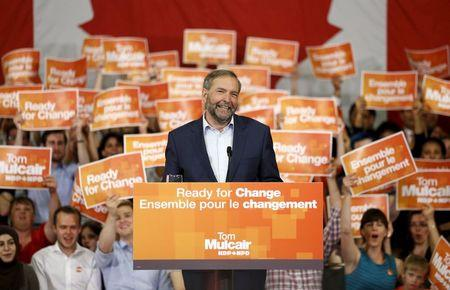 NDP leader Mulcair reacts to applause during a rally in Ottawa