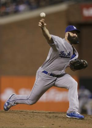 Los Angeles Dodgers pitcher Brian Wilson throws against the San Francisco Giants during the eighth inning of a baseball game in San Francisco, Tuesday, Sept. 24, 2013. (AP Photo/Jeff Chiu)
