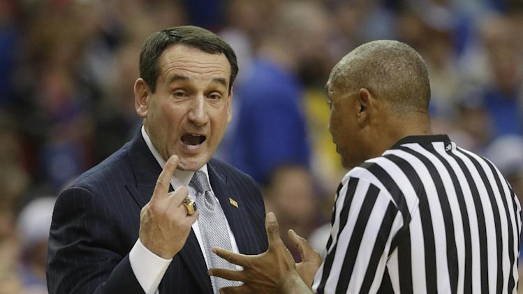 Duke coach Mike Krzyzewski talks with a referee during the first half of an NCAA college basketball game against Kentucky at the Georgia Dome in Atlanta Tuesday, Nov. 13, 2012. (AP Photo/Dave Martin)