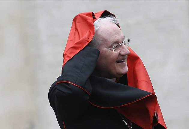 Cardinal Ouellet of Canada arrives for a meeting at the Synod Hall in the Vatican