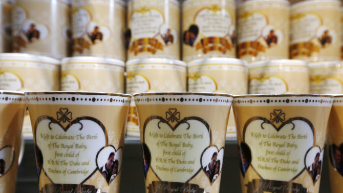 Souvenir cups to mark the forthcoming birth of Prince William and Kate, Duchess of Cambridge's baby are seen on display in a souvenir shop in central London, Wednesday, July 10, 2013. (AP Photo/Sang Tan)