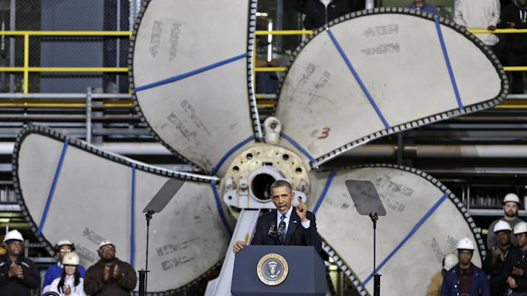 Standing in front of a ships propeller, President Barack Obama, gestures during a speech about automatic defense budget cuts, Tuesday, Feb. 26, 2013, at Newport News Shipbuilding in Newport News, Va.  (AP Photo/Steve Helber)