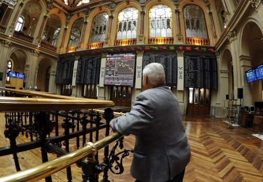 <p>A man looks at the IBEX-35 index curve at the Madrid stock exchange. European share prices traded mixed on Tuesday as investors weighed up the prospect of a new bond-buying scheme later this week from the European Central Bank.</p>
