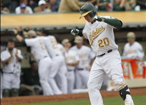 Donaldson, Straily lead A's past Giants 4-1