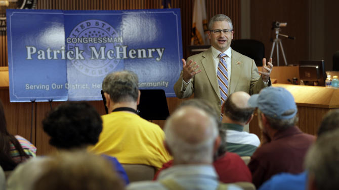 In this photo taken Aug. 5, 2013 Rep. Patrick McHenry speaks to a full house during a town hall meeting in Lincolnton, N.C. McHenry's loudest constituents have no desire to see conciliation on gridlocked Capitol Hill, unless it comes from President Barack Obama and his fellow Democrats. (AP Photo/Chuck Burton)