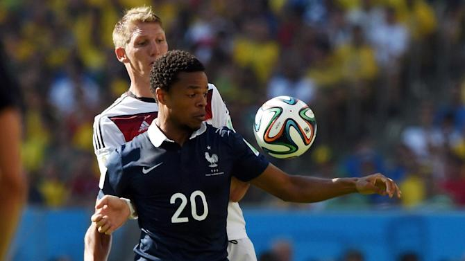Loic Remy (front) fends off Bastian Schweinsteiger during the World Cup quarter-final between France and Germany at the Maracana Stadium in Rio de Janeiro on July 4, 2014